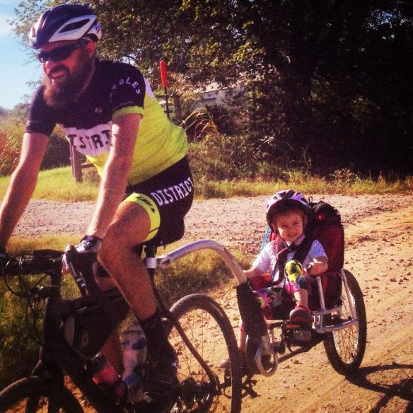 Chris Peters and his daughter, Ainsley, grind some gravel. Ainsley has been battling leukemia for a year.
